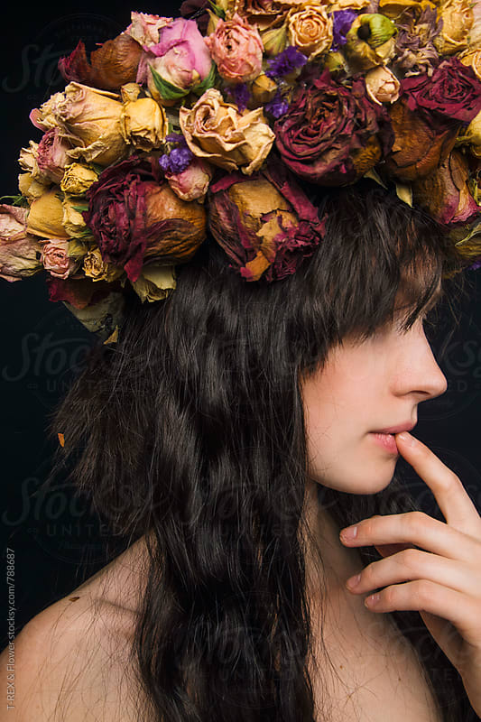 Young woman wearing flower wreath by Danil Nevsky for Stocksy United