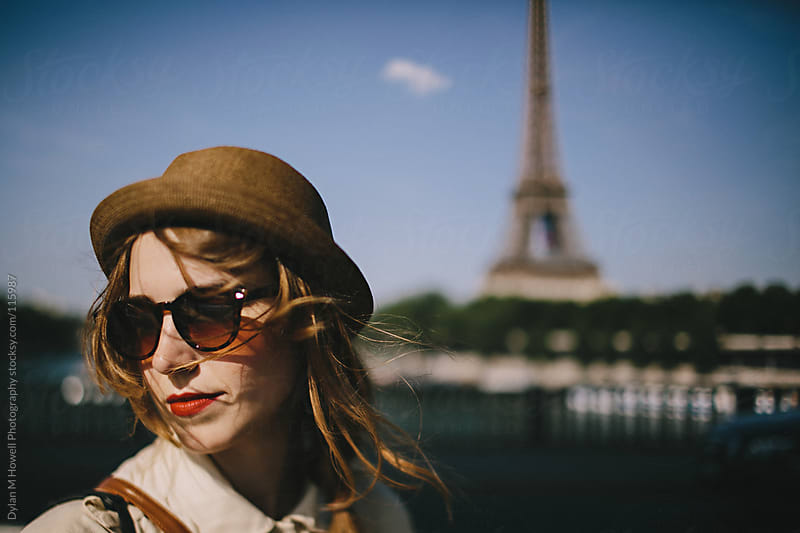 Girl in front of Eiffel Tower by Dylan M Howell Photography for Stocksy United