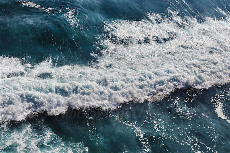 Aerial view of a powerful ocean wave braking close to the shore by Jovana Milanko for Stocksy United