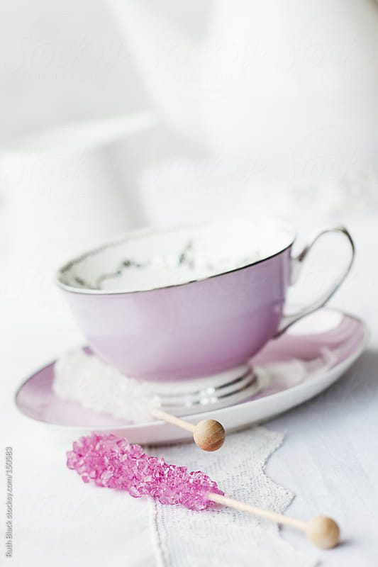 Rock crystal candy sticks and vintage teacup by Ruth Black for Stocksy United