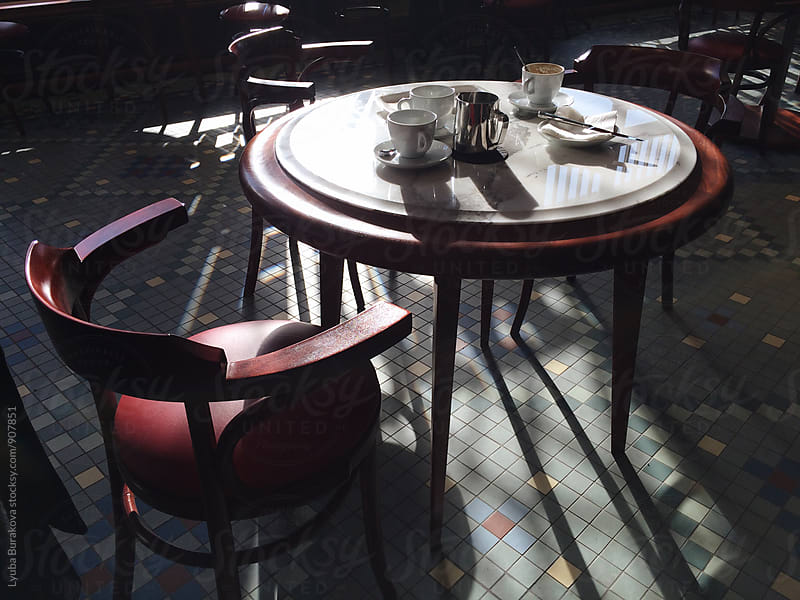 Table in cafe with empty cups by Liubov Burakova for Stocksy United
