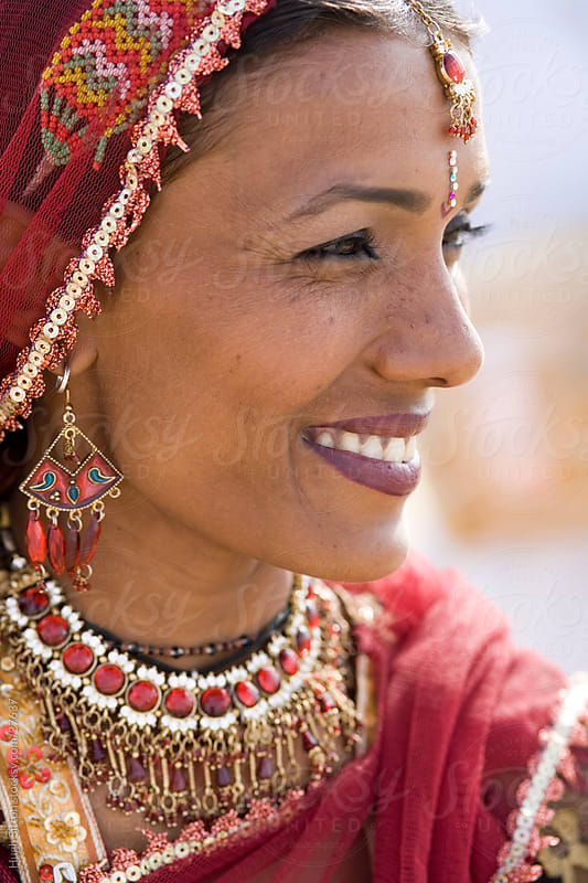 Smiling female Rajasthani dancer. by Hugh Sitton for Stocksy United