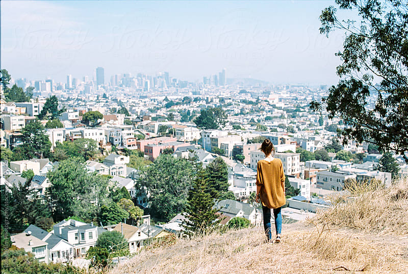 Woman overlooking city of San Francisco by Daniel Kim Photography for Stocksy United