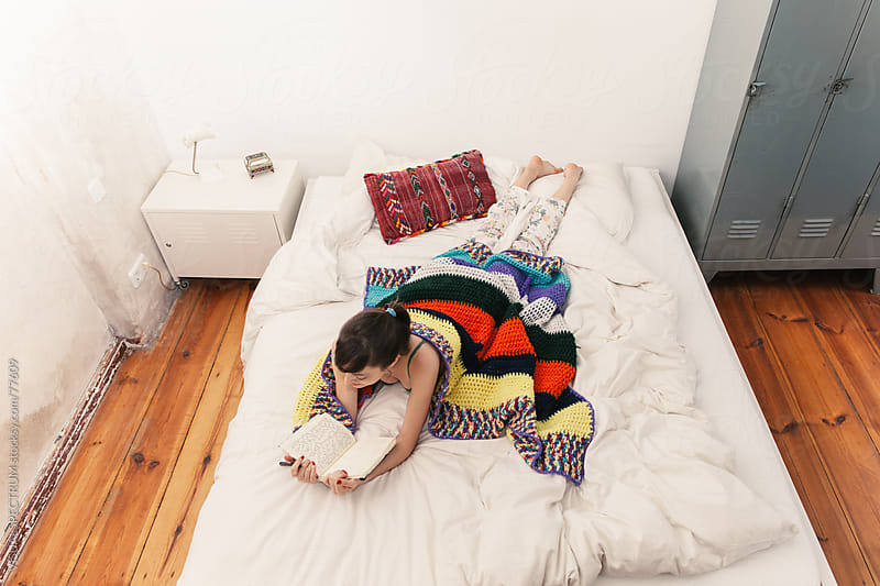 Young Woman Reading Journal on Bed by VISUALSPECTRUM for Stocksy United