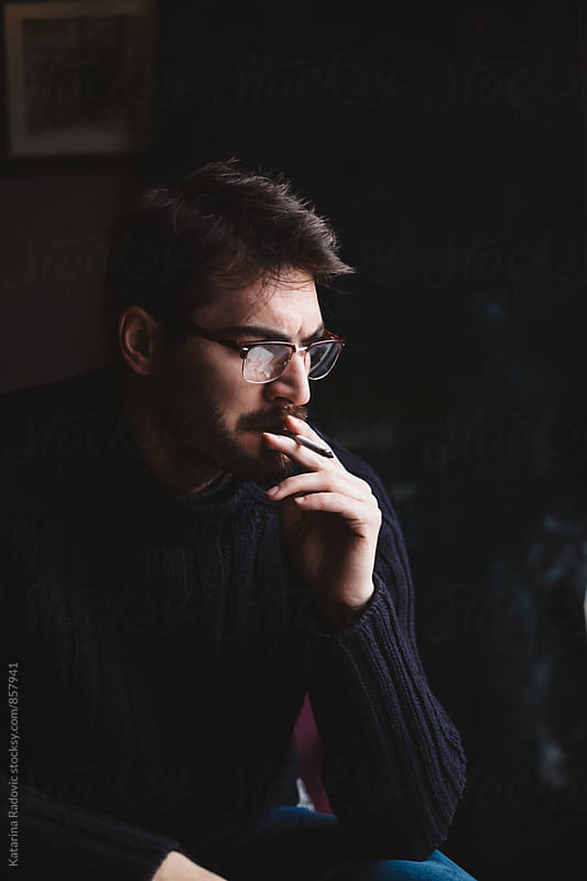 Handsome Man Smoking Cigarette by Katarina Radovic for Stocksy United