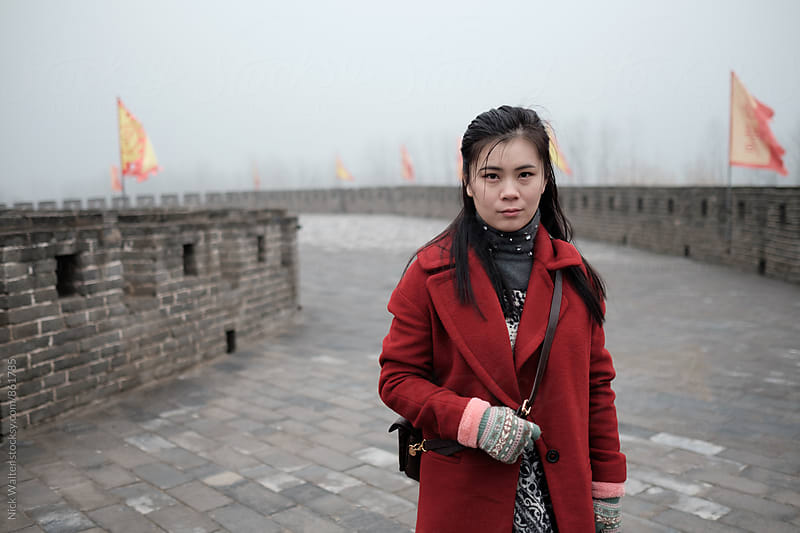 Chinese Woman In Red Coat by Nick Walter for Stocksy United