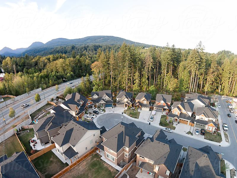Housing Development Near Forest by Ronnie Comeau for Stocksy United