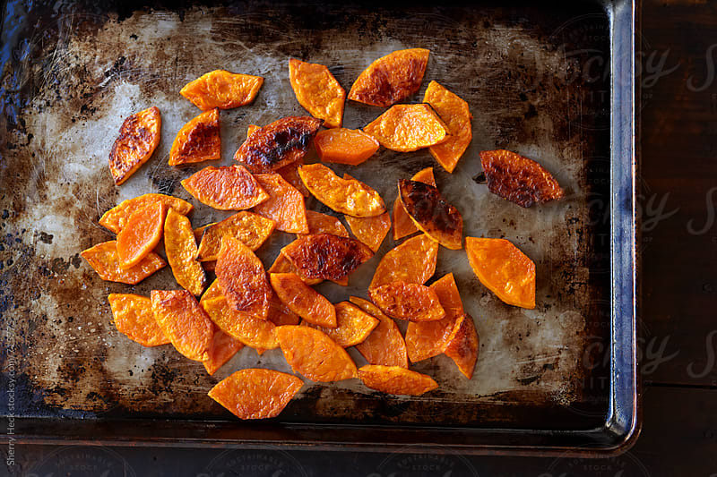 Roasted butternut squash on sheet pan by Sherry Heck for Stocksy United
