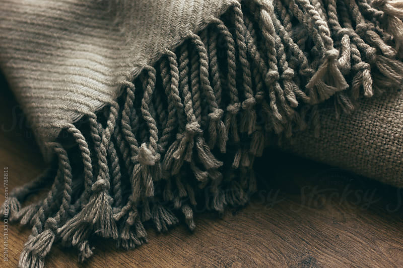 Macro of a blanket at home on winter. by BONNINSTUDIO for Stocksy United