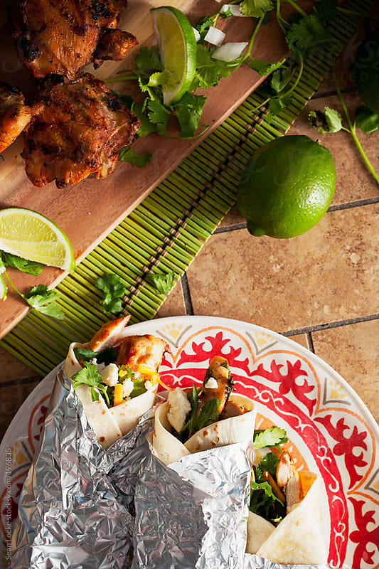 Fiesta: Plate Of Chicken Tacos With Cilantro by Sean Locke for Stocksy United