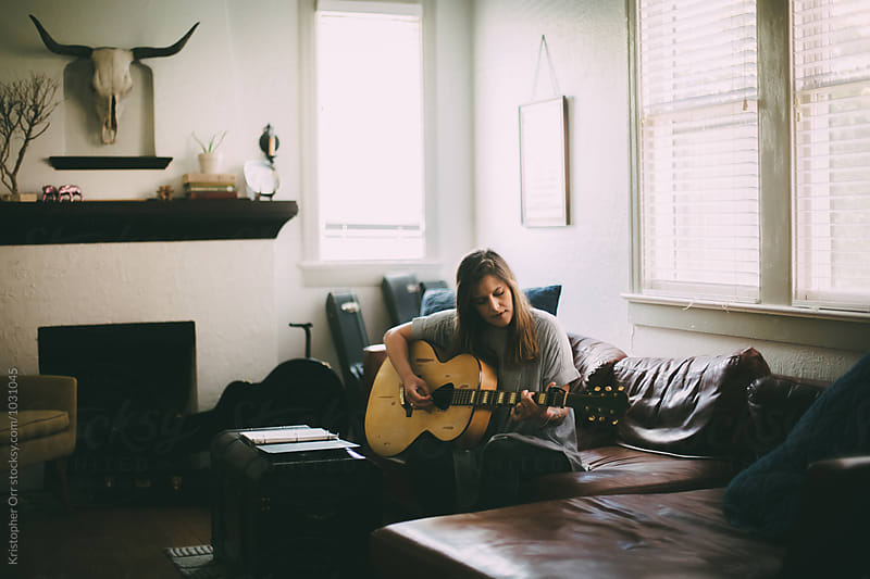 Woman Practicing Guitar at Home by Kristopher Orr for Stocksy United