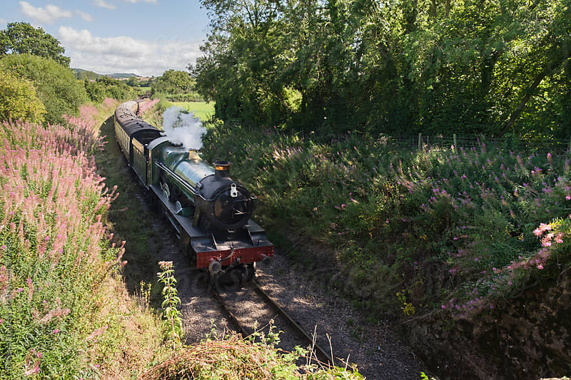 Vintage steam train watched from above by Rebecca Spencer for Stocksy United