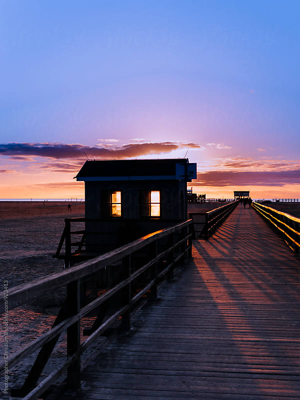 Sunset at the pier by Photographer Christian B for Stocksy United