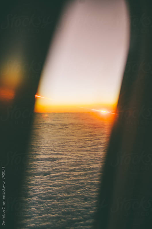 Sunrising out of plane window by Dominique Chapman for Stocksy United
