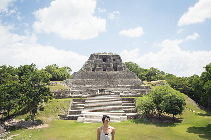 Woman with Ancient Mayan Temple in Background by MEGHAN PINSONNEAULT for Stocksy United