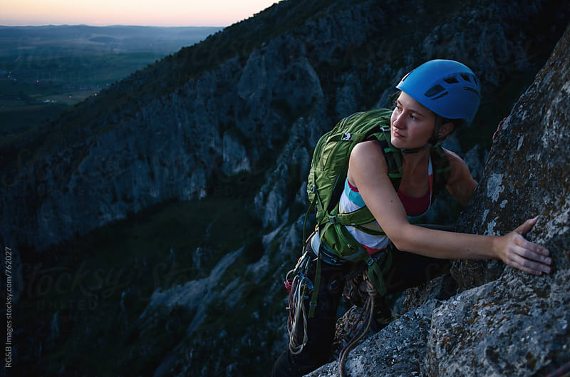 Woman rock climbing outdoor at dawn by RG&B Images for Stocksy United