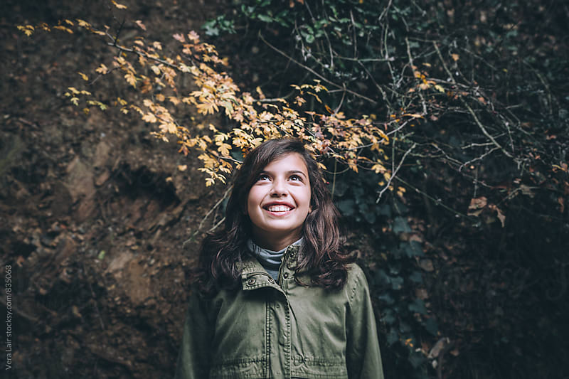 Portrait of a young girl in the woods by Vera Lair for Stocksy United