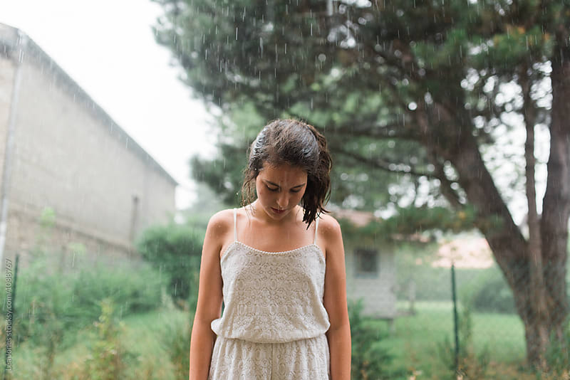 teen in the rain by Léa Jones for Stocksy United