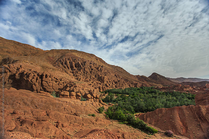 Moroccan village nestled in rocky hillside by Maximilian Guy McNair MacEwan for Stocksy United