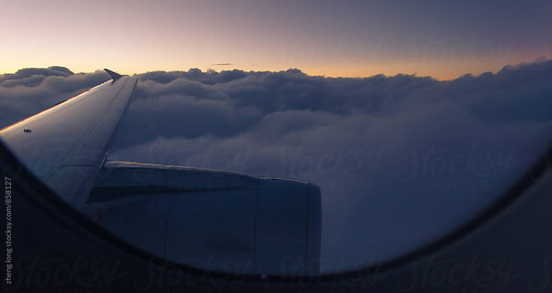 sunrise view from plane by zheng long for Stocksy United