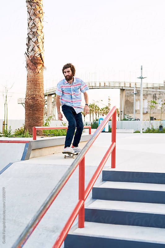 Young bearded skater riding before doing trick by Guille Faingold for Stocksy United