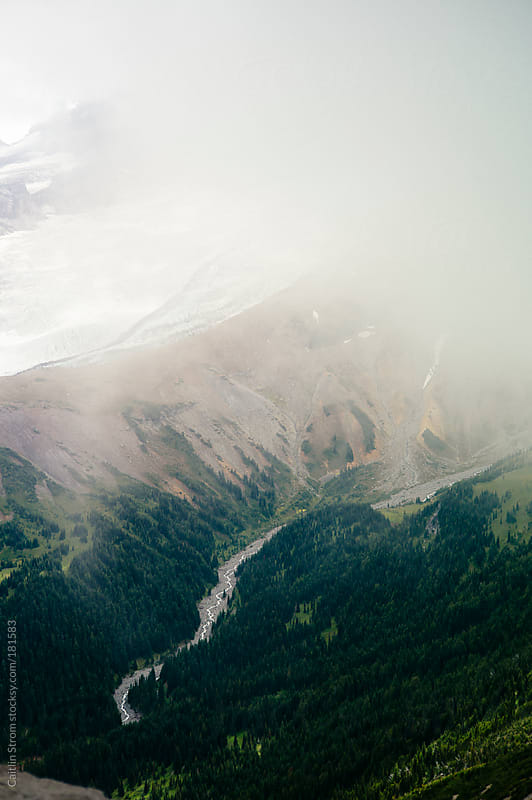 River from misty mountain by Caitlin Strom for Stocksy United