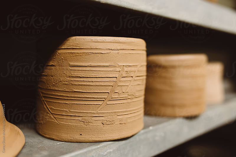 Clay mugs with carved designs by Carey Shaw for Stocksy United