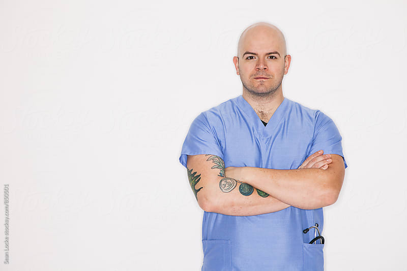 Medical: Male Nurse Standing Confidently by Sean Locke for Stocksy United