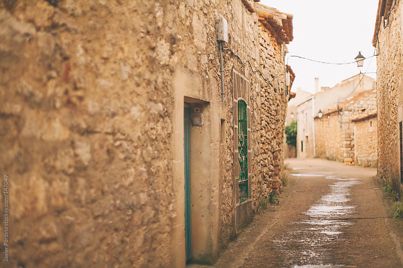 detail of the streets of a small town in spain by Javier Pardina for Stocksy United