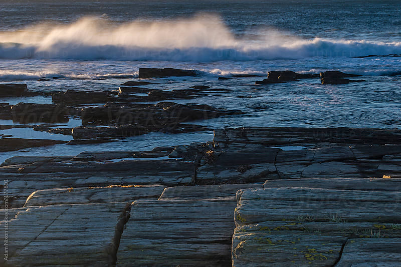 Back lit waves on the Maine Coastline by Adam Nixon for Stocksy United