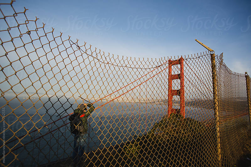 Man photographing the Golden Gate Bridge by michela ravasio for Stocksy United