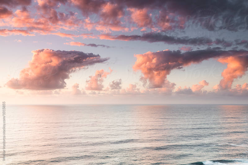 Colorful sunset over ocean by Marilar Irastorza for Stocksy United