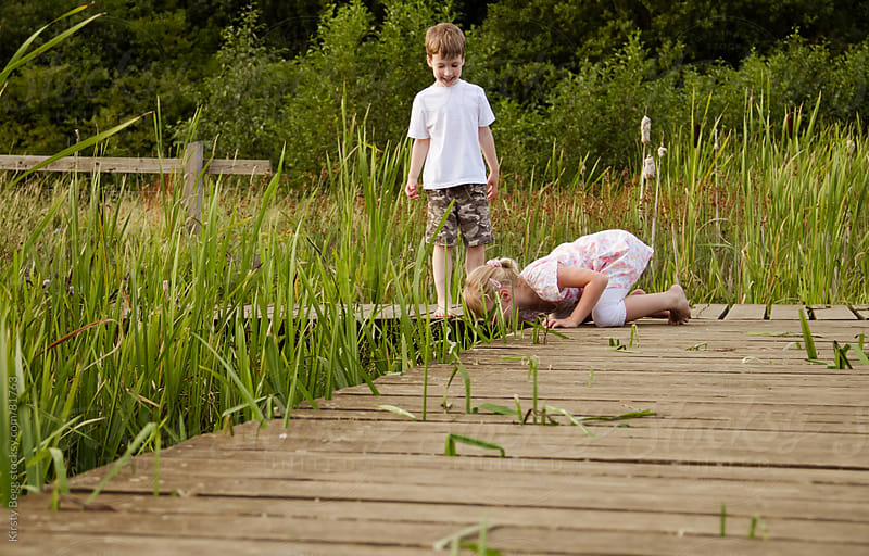 Nature Reserve boardwalk with boy and girl by Kirsty Begg for Stocksy United
