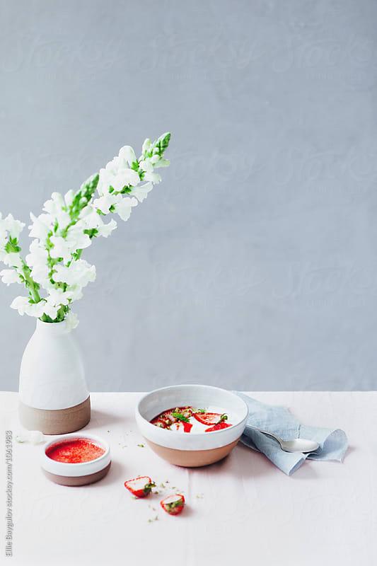 Strawberry yogurt bowl by Ellie Baygulov for Stocksy United