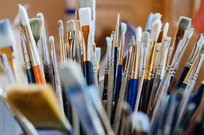 A collection of artist paintbrushes by Cara Dolan for Stocksy United