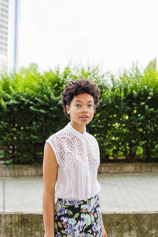 Beautiful afro woman walking around the city on a summer day by michela ravasio for Stocksy United