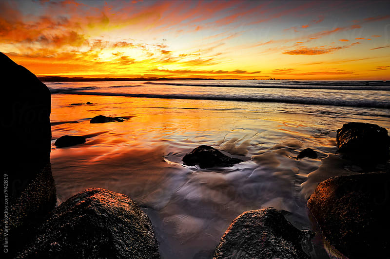 beach sunset. Coolangatta, Australia. by Gillian Vann for Stocksy United