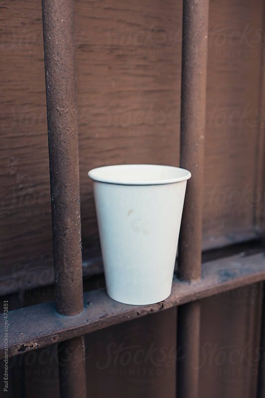 Discarded paper cup by Paul Edmondson for Stocksy United
