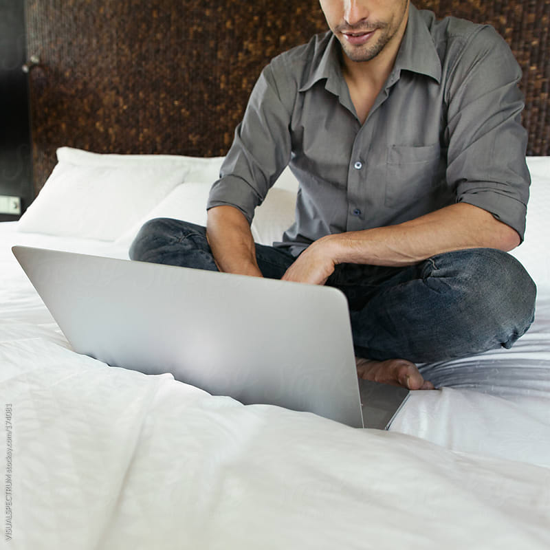 Man With Laptop on Bed by VISUALSPECTRUM for Stocksy United