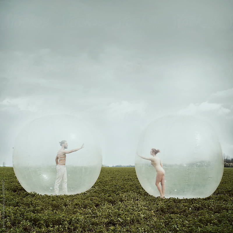 Artistic photo of a couple in a big balloon by Jovana Rikalo for Stocksy United