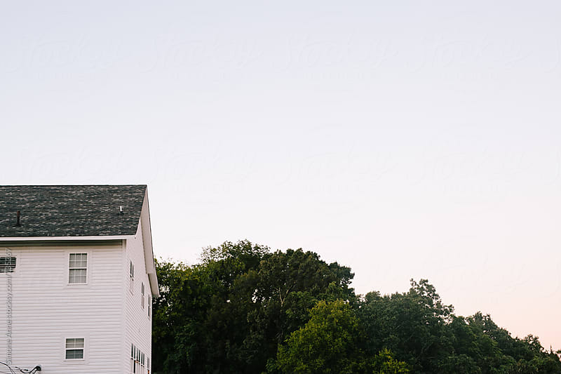 White Southern house at dusk by Simone Anne for Stocksy United