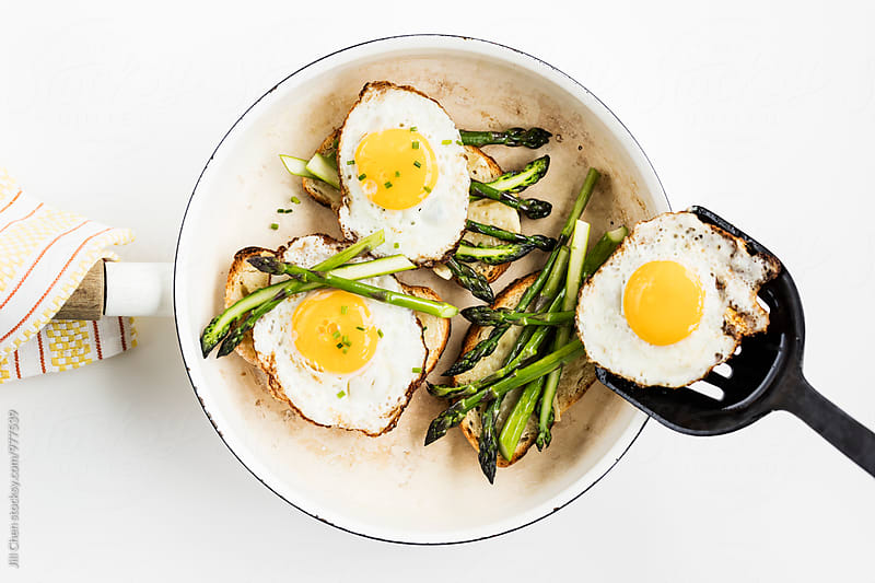 Fried Egg on Toast with Asparagus and Cheese by Jill Chen for Stocksy United