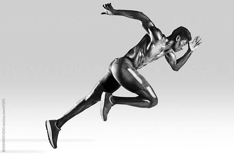 Sprinter african muscular man by BONNINSTUDIO for Stocksy United