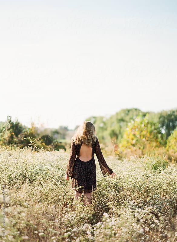 In a field of wildflowers by Marta Locklear for Stocksy United