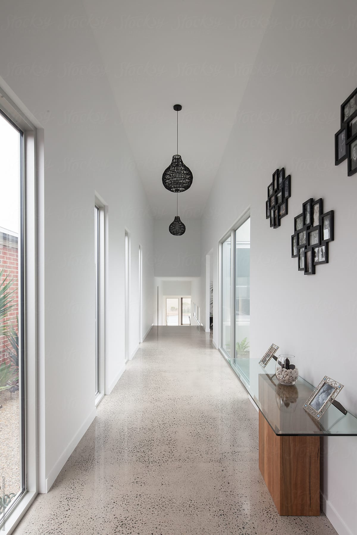 Wide Hallway In Contemporary Home With Polished Concrete Flooring By Rowena  Naylor For Stocksy United