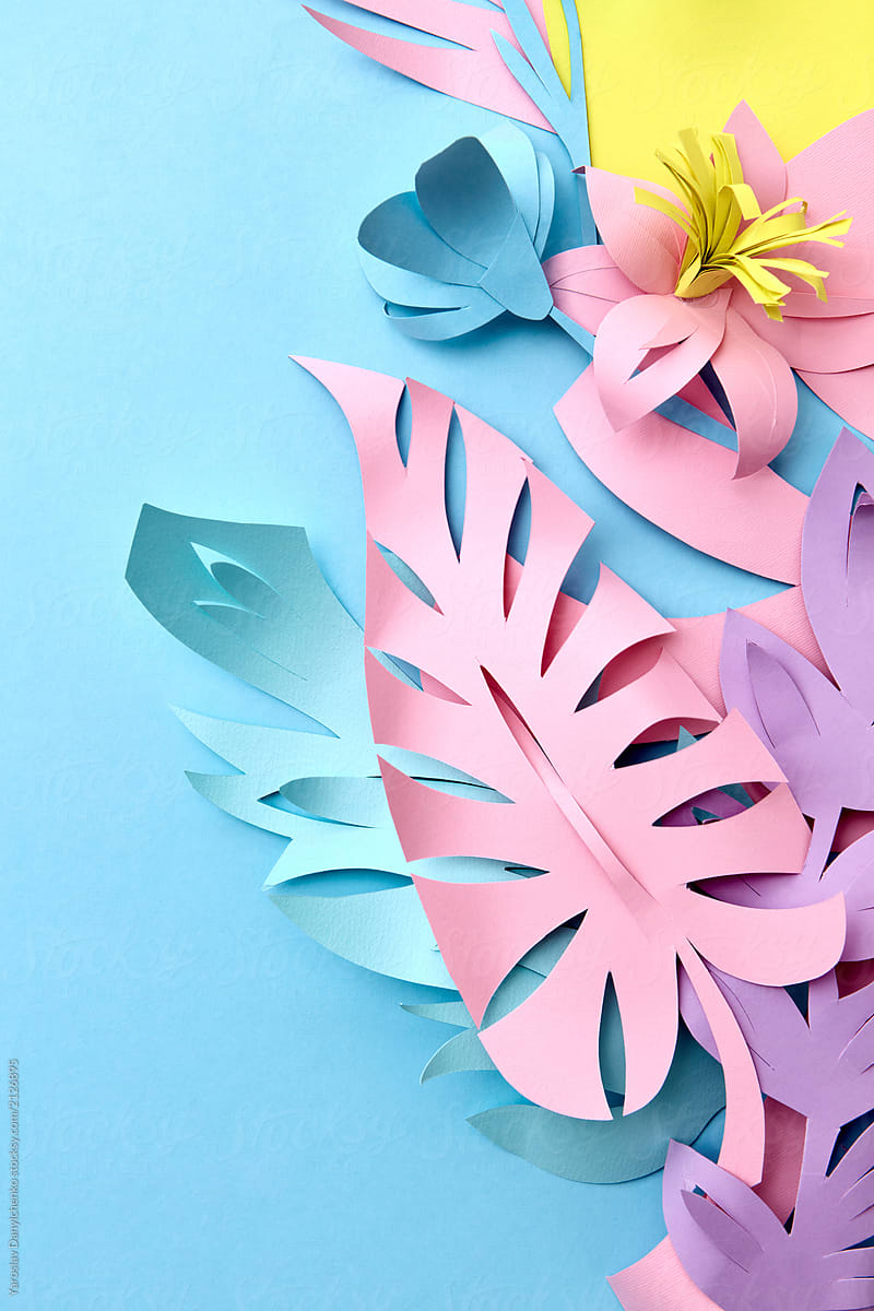 Colorful Handmade Paper Flowers And Tropical Leaf On A Blue Back