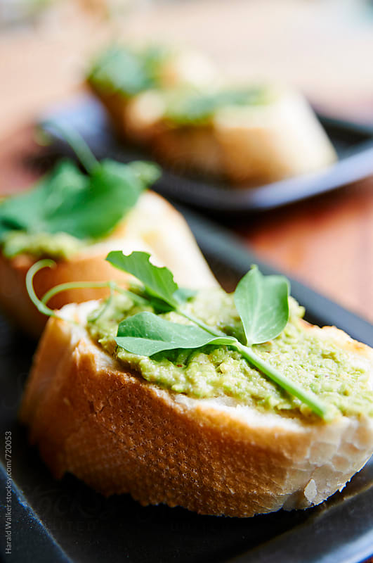 Pea Bruschetta by Harald Walker for Stocksy United