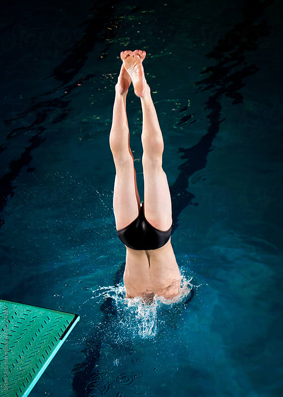 Tall Male Diver Rips Entry into Swimming Pool Water by Brian McEntire for Stocksy United