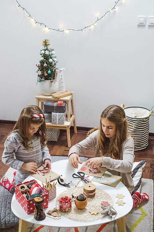 Kids Making Christmas Cards at Home by Aleksandra Jankovic for Stocksy United