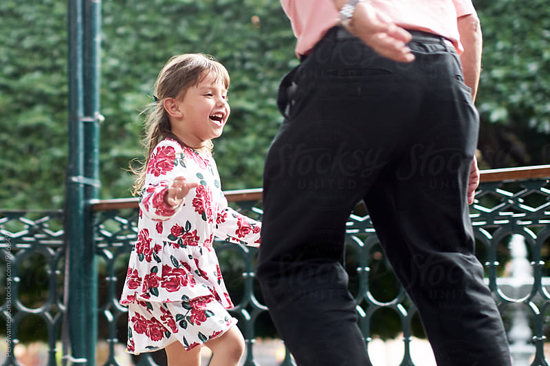 Ecstatic 4 year old playing with her grandfather by Per Swantesson for Stocksy United